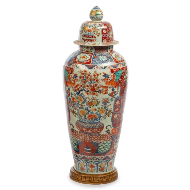 A Fine Pair of Grand Japanese Imari Porcelain Covered Jars Circa 1900 Each raised on a custom gilt-wood base. Height...