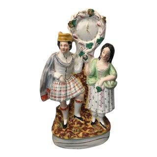 19th Century Staffordshire Figurine Scottish Highlander Couple With Clock For Sale
