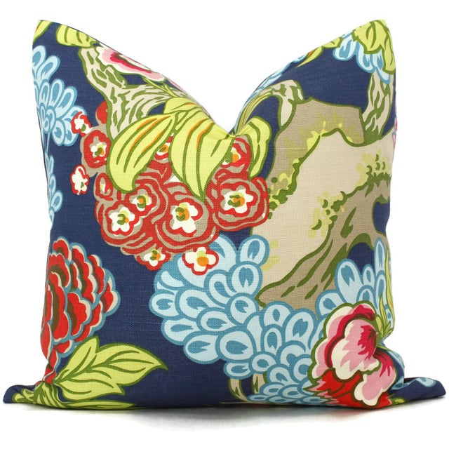 Add a pop of color to your room with this bold floral pillow cover with a bit of an Asian flair. Shades of pink, orange,...
