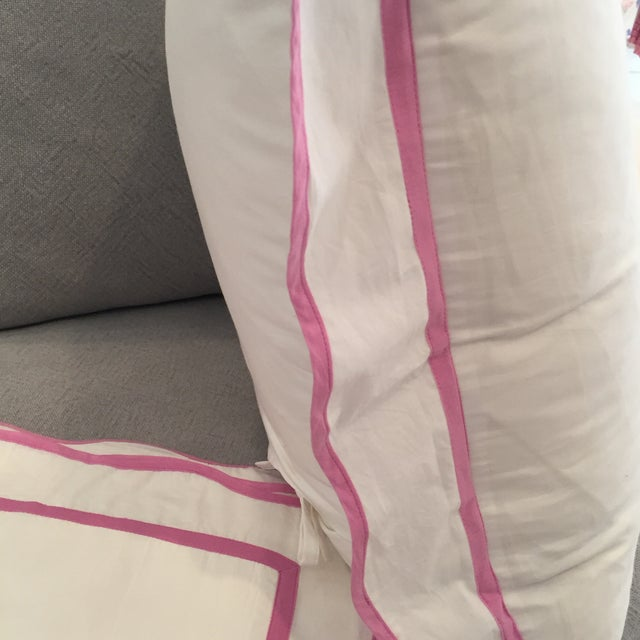Pair classic crisp white cotton euro shams with pink scallop edge. Never used.