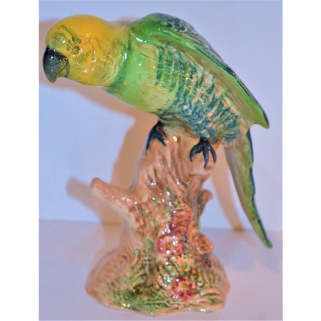 This is a beautiful Beswick England porcelain yellow headed Parrot. This pretty bird is perched on a tree that stands 6...
