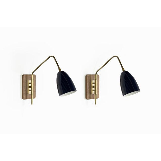 """The """"Elska"""" wall mount sconce or reading light is strongly influenced by Scandinavian, Danish and Italian Mid-Century..."""