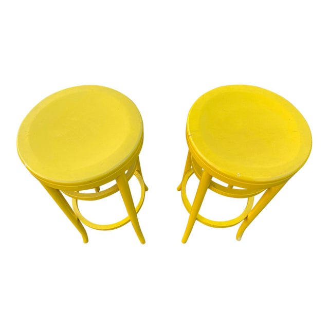 A wonderful pair of all original yellow Thonet tall stools with tags.