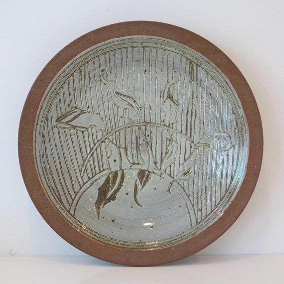 A beautiful mid-1970s stoneware plate by david westmeier. This plate features an incised branch with leaf design with a...