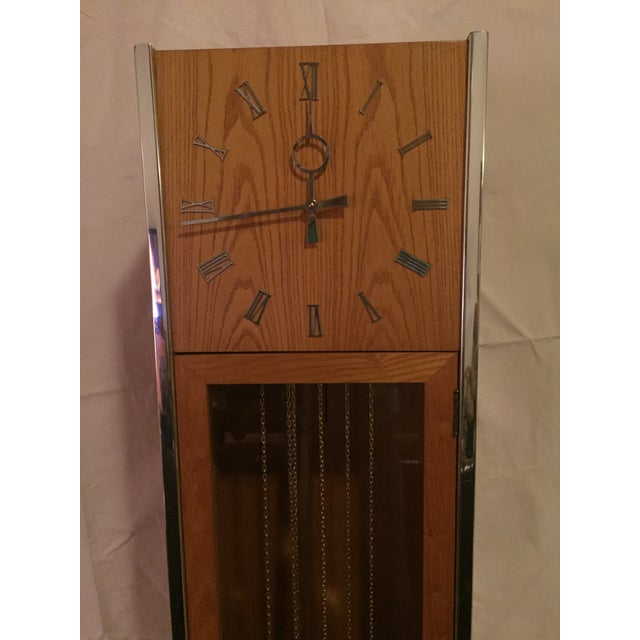 A vintage Modernist Grandfather floor clock. The clock is in the style of George Nelson, one of the most famous Mid...