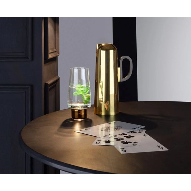 For any liquid refreshment; a vessel made from spun brass, polished and then dipped in a warm gold wash to give a subtle...