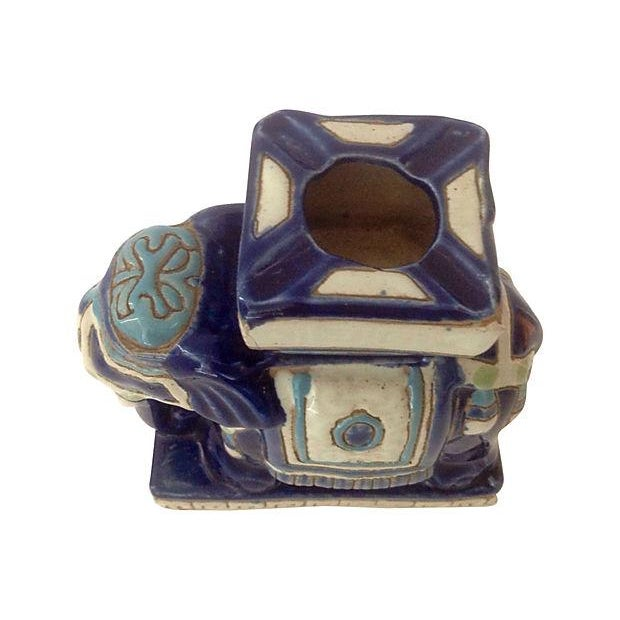 Blue, white and green hand-painted ceramic elephant ashtray. No maker's mark.