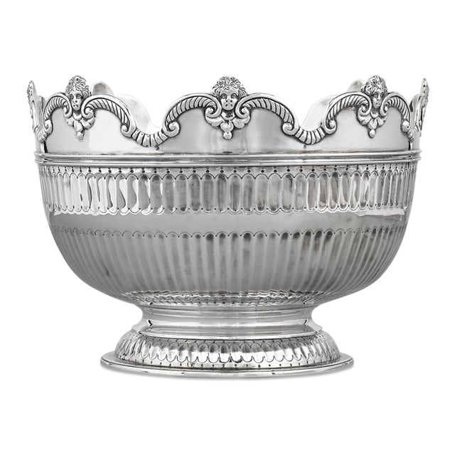 Diminutive cherubs crown the rim of this delightful sterling silver bowl created by the London Assay Office. The elegant...