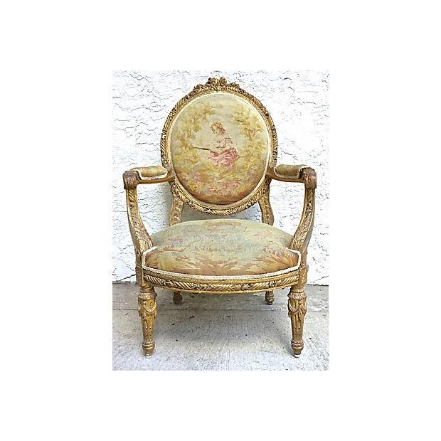 Antique, early 19th century, French, Charles X, aubusson upholstered fauteuil with gilt carved frame. Medallion backrest...