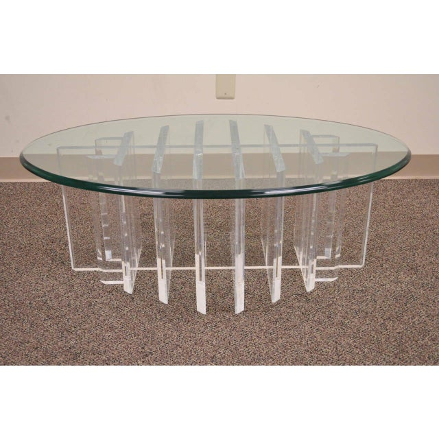 Very unique vintage mid-century modern lucite coffee table with a thick and heavy grid form sculptural base in the manner...