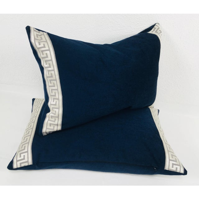 This is a pair of navy blue plush chenille lumbar pillows with embroidered Greek key border in silver and gray. Pillows...