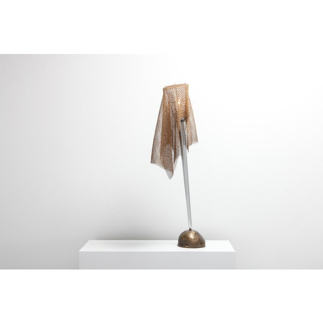 Unusual post-modern table lamp in bronze, chromed steel and chain mail by Toni Cordero for Artemide. Fits well in an...