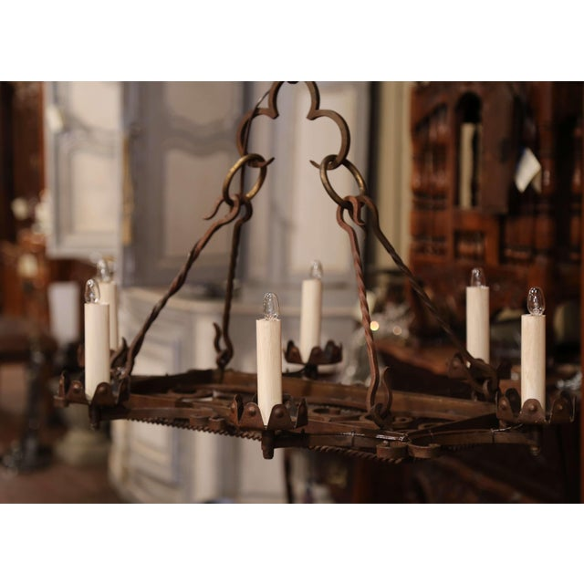 Decorate a breakfast nook with this rustic iron antique light fixture. Forged in France circa 1900, the elegant Gothic...