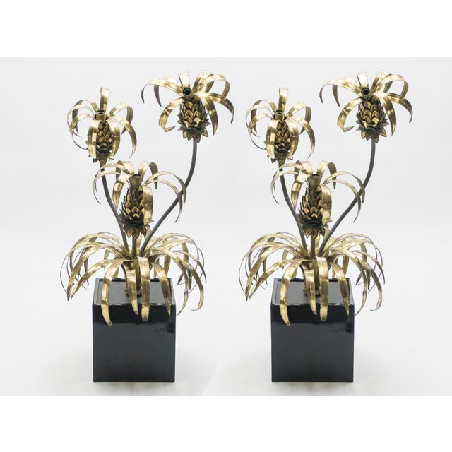 A rare pair of substantial floor lamps by renowned design firm Maison Jansen, created during the 1970's in France. The...