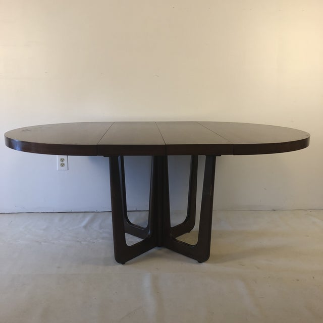 Lovely mid century modern dining table in the style of Adrian Pearsall, Vladimir Kagan, or Harvey Probber. Sculptural base...