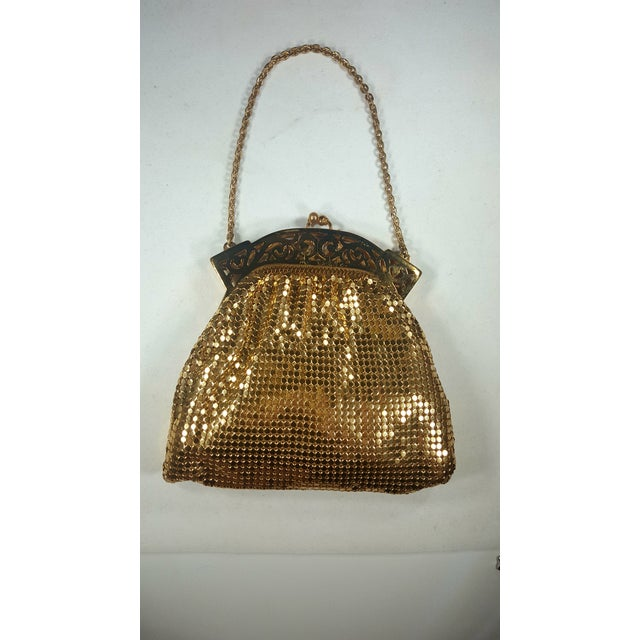 Gorgeous vintage Whiting and Davis gold mesh evening bag with stunning detail on the frame. This bag is from the 1940S and...