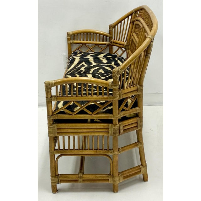 This is a 1960s Chinese chippendale style bamboo settee newly recovered in Ralph Lauren. It is in very good condition.