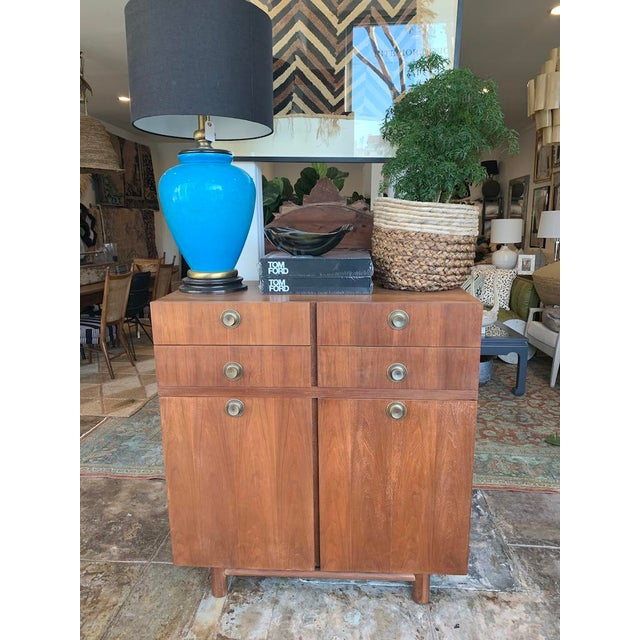 Mid Century Modern American of Martinsville Highboy refinished to a lovey contemporary look. This highboy has drawers...