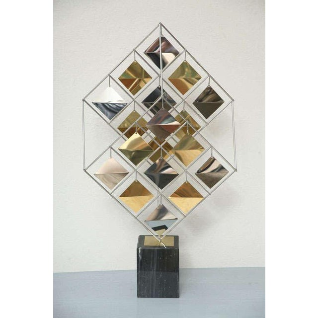 Unusual and rare brass and chrome cube sculpture on black marble base. Signed C. Jere '85.