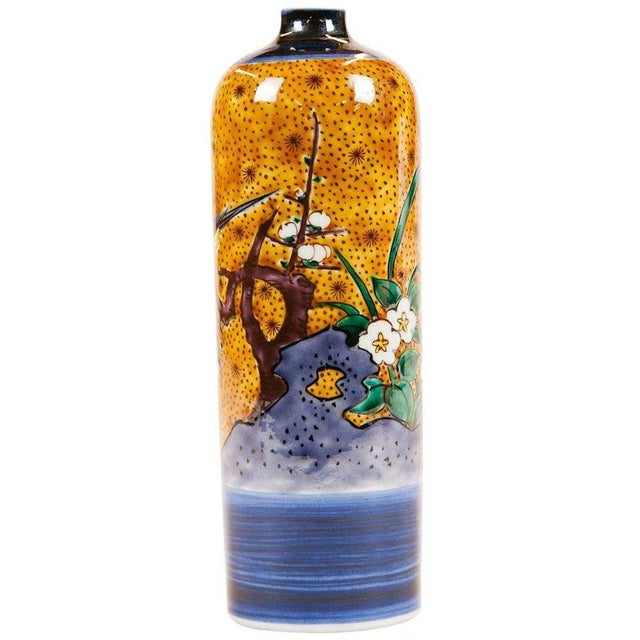 Painted porcelain vase in orange, blue, and gold, designed and commissioned by Lucia Lawrence. Bud vase with motif of...