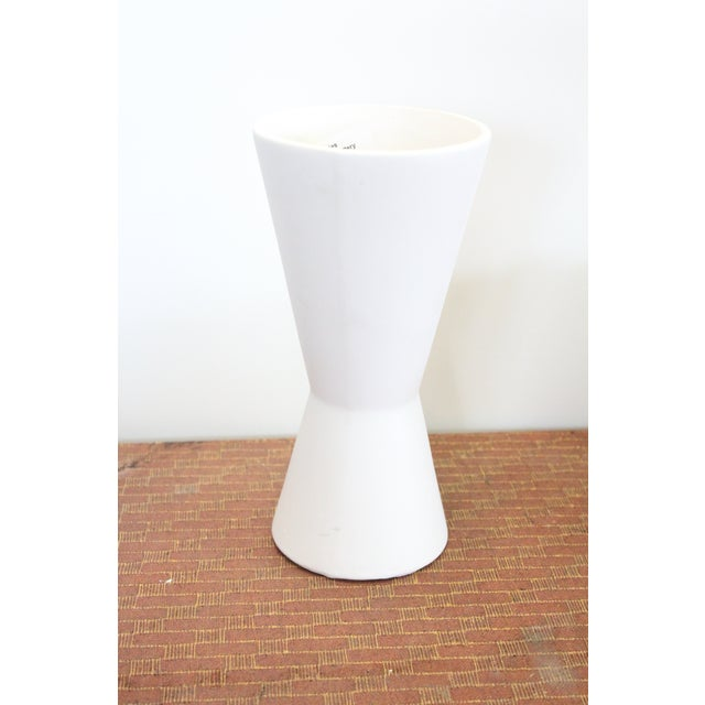 Bright white hourglass shaped modern vase. Makes a great table accessory!
