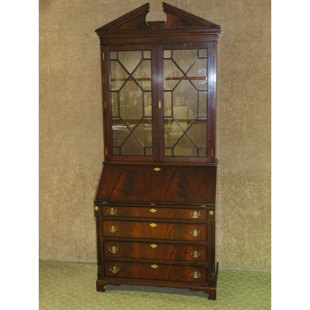 Two piece secretary desk with drop front desk and leather panel. This desk has a regency style. Made of mahogany. The...