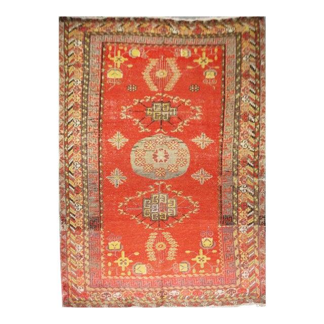 Vintage Hand Knotted Khotan Circa 1900 - 4′9″ × 9′ For Sale