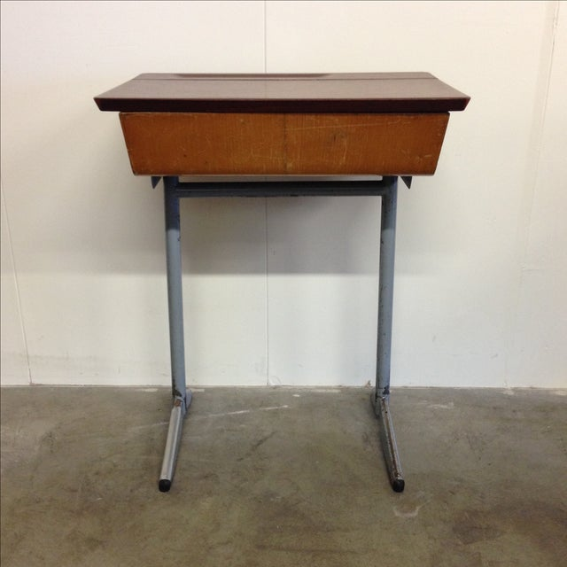 This vintage Mid-Century school desk originally purchased in Belgium is the perfect item to throw you into a retro daze!...