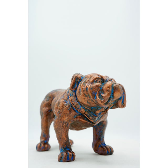 A nicely weighted statue of a Vintage Bulldog with copper and blue verdigris patina. A fun decorative object!