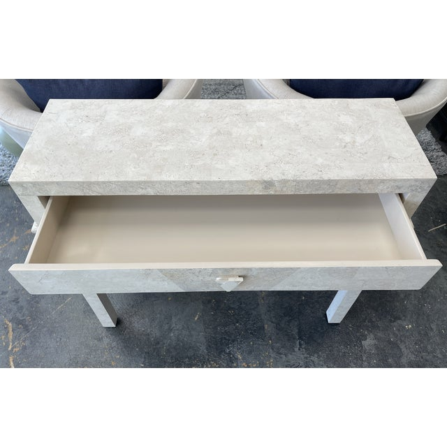 Lovely postmodern console table made of limestone. This piece is in great vintage condition with age appropriate wear....