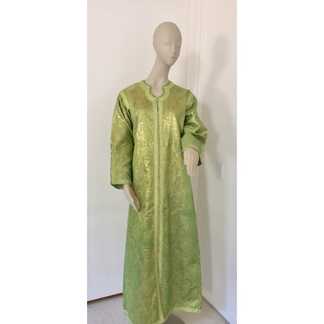 Elegant Moroccan caftan in green and gold lame metallic and embroidered trim, circa 1970s. This long maxi dress kaftan is...