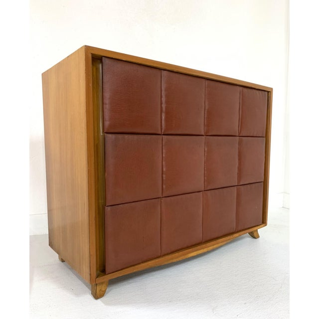 Gilbert Rohde for Herman Miller Three-Drawer Chest. Front of drawers are padded naugahyde and the frame of the chest is...