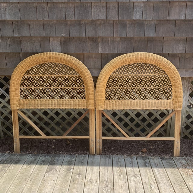 This is a vintage pair of twin headboards. These headboards features a high arch curved wicker frame with wrappings and...