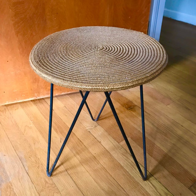 Unusual mid century accent table with a custom spiral woven top and an iron hairpin base.