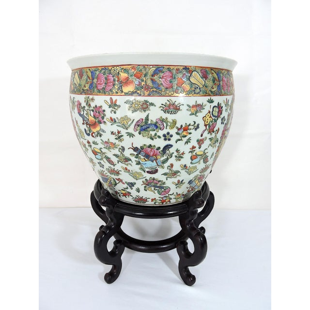 Early 20th century Chinese white porcelain planter very finely hand painted with a single gilt border. Enamelled...