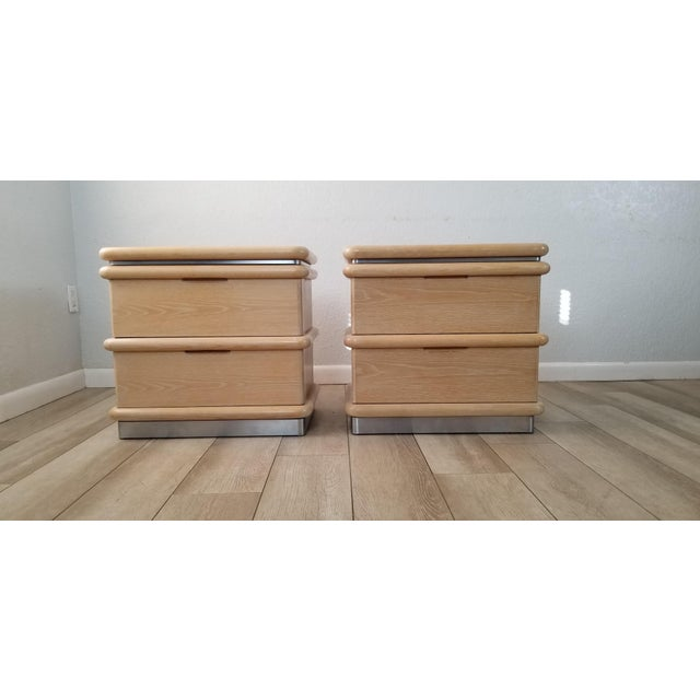 We are privileged to be offering for sale this Stunning Pair of Vintage / Postmodern style two-drawer blonde / Cerused oak...