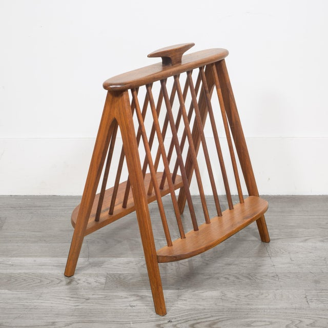 ABOUT A mid-century modern sculpted walnut record holder/magazine rack designed by Arthur Umanoff. The piece is solid...