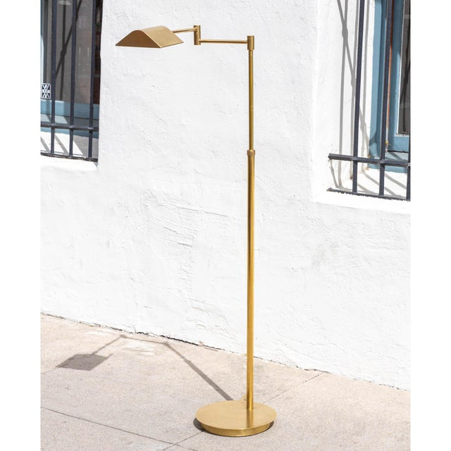 Lovely! Mid-Century Modern adjustable pharmacy floor lamp in brass! The piece is in great vintage and the height is...