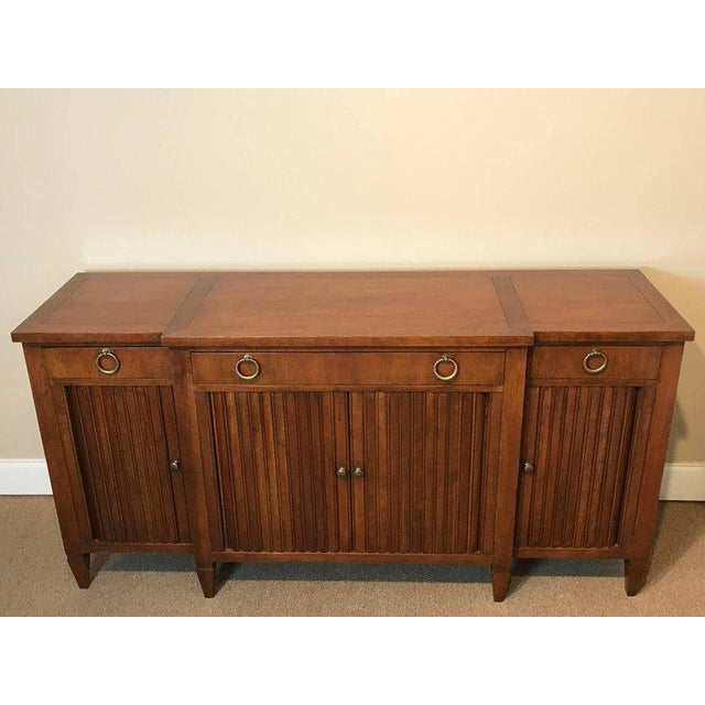 T.H. Robsjohn-Gibbings style sideboard by Baker, fitted with three drawers with ring handles, and three lower tambour...