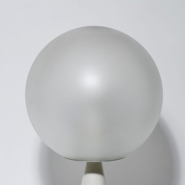 "A table light ""Bilia"", designed by Gio Ponti for fontana Arte c.1970. Enameled metal base with a blown satin glass ball...."
