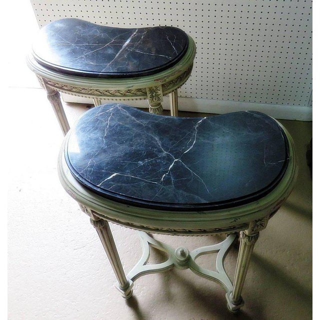 Pair of petite Louis XVI style demilune distressed painted marble-top consoles.
