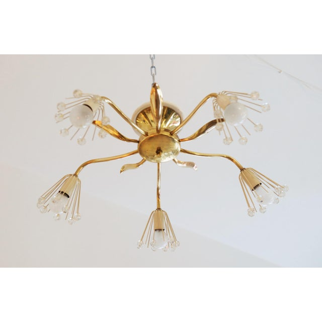 This chandelier features a pair of E14 sockets and was designed by Emil Stejnar for Rupert Nikoll in Vienna in the 1950s....