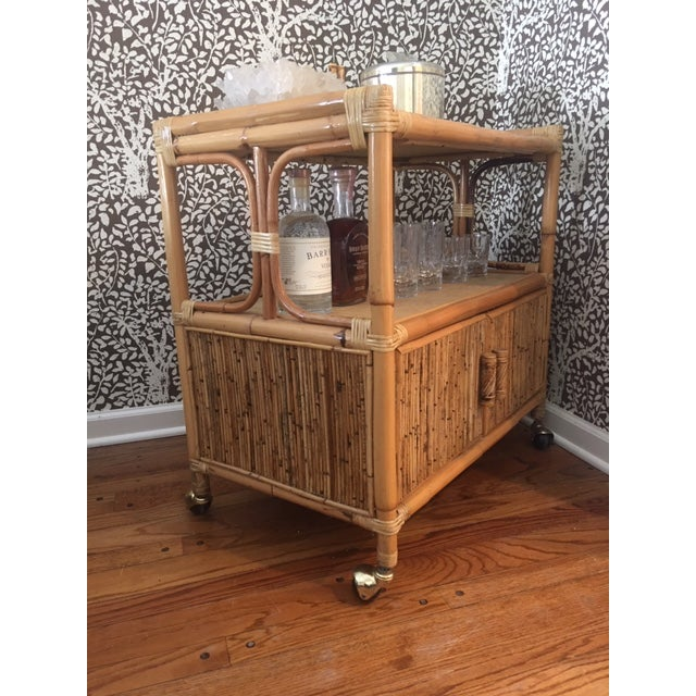 Boho Chic 1970s Hollywood Regency Rattan Tiered Bar Cart on Brass Castors For Sale - Image 3 of 8