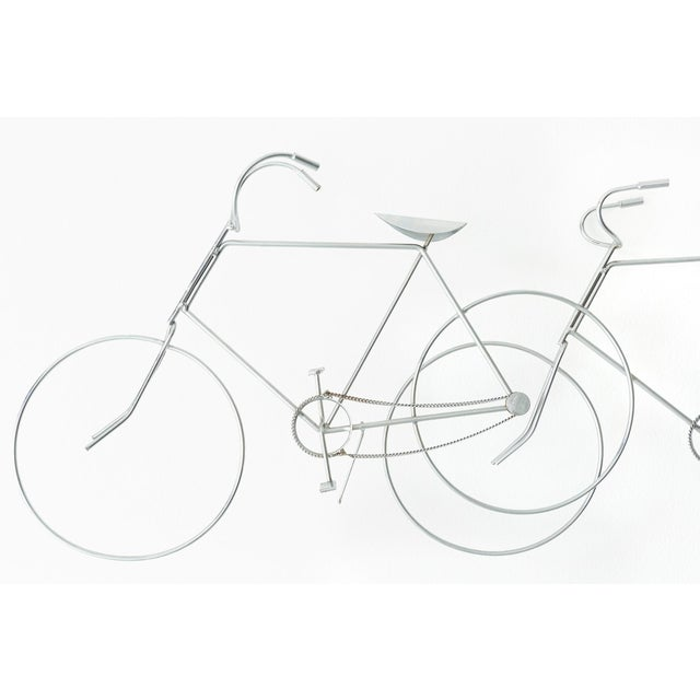 This is a bicycle wall sculpture designed by Curtis Jere in the USA. This pieces is made of metal and circa 1970s....