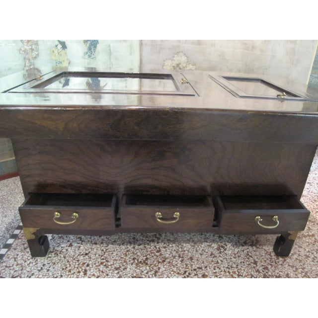 Mid 20th century Japanese Hibachi table in dark wood grain with 3 lower pull out drawers and 2 upper food preparation...