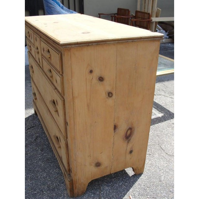 Fine and Unusual craftsmanship, made entirely of pine wood and 7 drawers. A wonderful piece of furniture.
