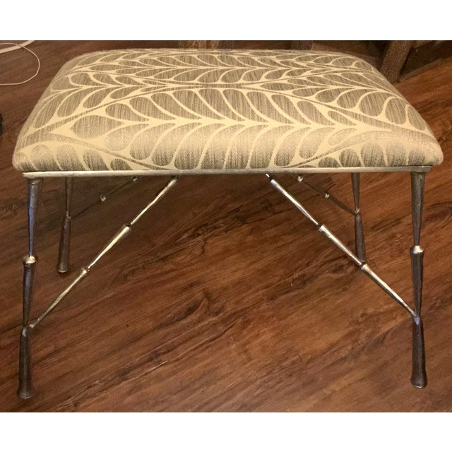 This stool features a hand-finished, antique nickel frame that is styled with tapered segments that echo bamboo stalks...