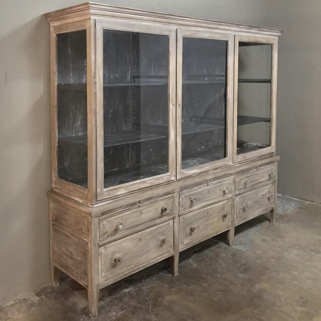 Antique French Louis XVI Whitewashed Bookcase ~ Vitrine features tailored lines, Three spacious glazed cabinets appear...