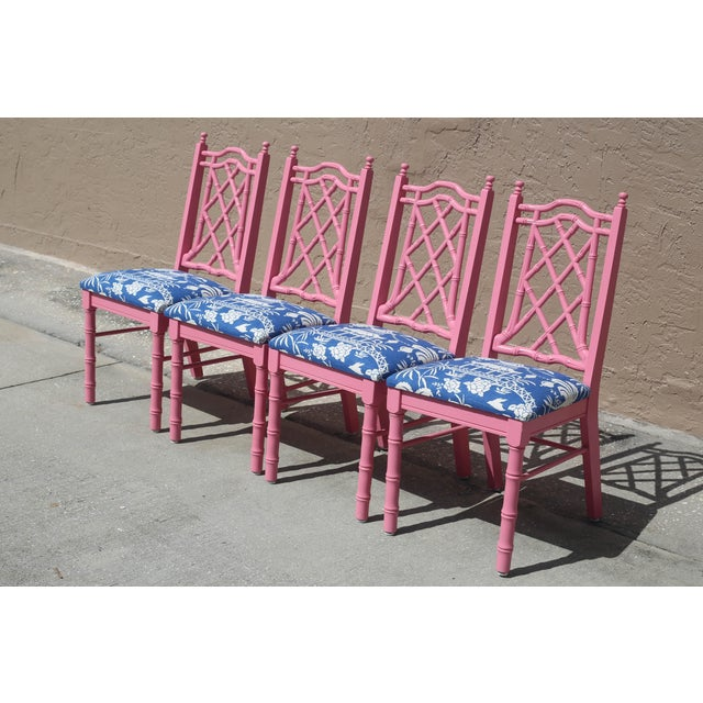 A vintage set of four faux bamboo dining chairs, painted high gloss pink. The seats are newly made, with new padding and...