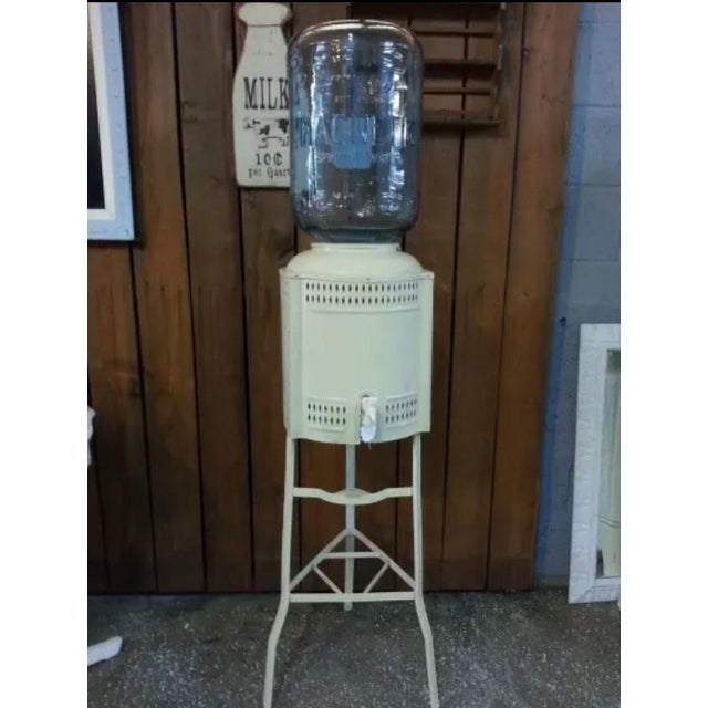 5 gallon blue glass water cooler. Magnetics sorting water from the hills of Hollywood, circa 1970s. Industrial design. Has...